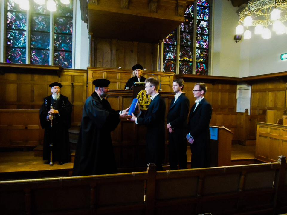 Here I get my PhD diploma handed out by Prof. Pierre van Baal. Photo by Bart Versteeg.